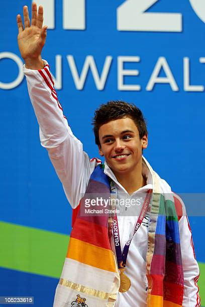Tom Daley of England poses with the gold medal won in the Men's 10m Platform Final at the Dr SP Mukherjee Aquatics Complex during day ten of the...