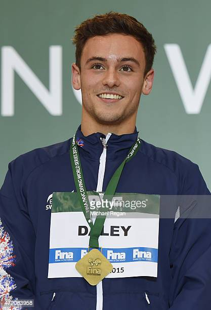 Tom Daley of Great Britain celebrates with his gold medal after winning the Men's 10m Final during the FINA/NVC Diving World Series at Aquatics...