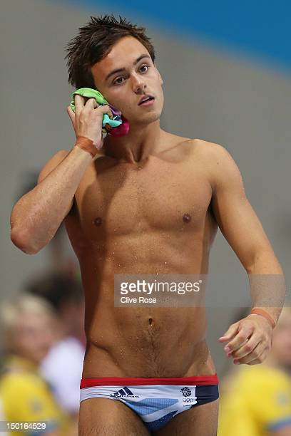 Tom Daley of Great Britain looks on after completing a dive in the Men's 10m Platform Diving Final on Day 15 of the London 2012 Olympic Games at the...