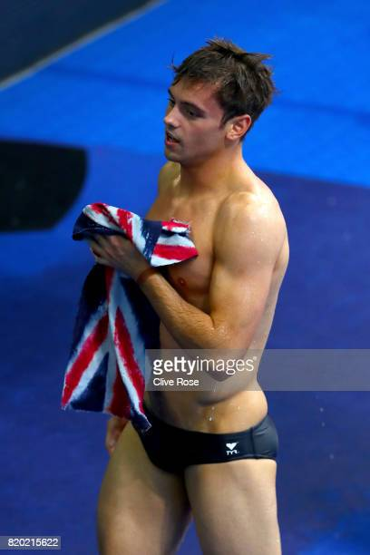 Tom Daley of Great Britain looks on during the competes during the Men's Diving 10m Platform semi final on day eight of the Budapest 2017 FINA World...