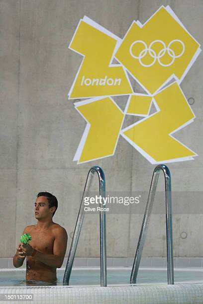 Tom Daley of Great Britain looks on during the Men's 10m Platform Diving Preliminary on Day 14 of the London 2012 Olympic Games at the Aquatics...