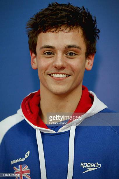 Tom Daley of Great Britain looks on during the Men's 10m Platform semi Final during the FINA Diving World Series at the Beijing National Aquatics...