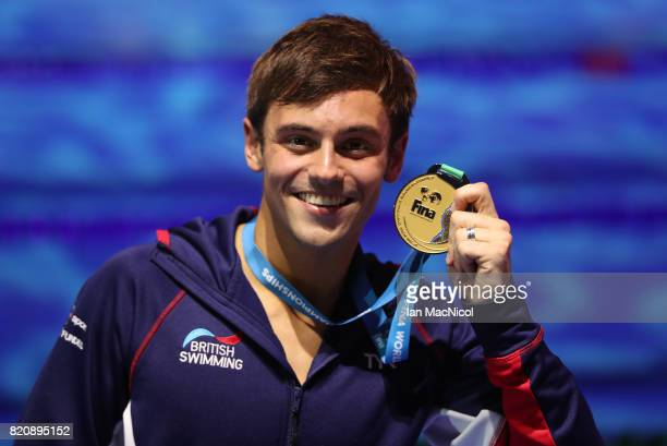 Tom Daley of Great Britain pose with his gold medal from the Men's 10m Platform during day nine of the FINA World Championships at the Duna Arena on...