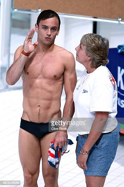 Tom Daley of Great Britain receives instructions from coach Jane Figueiredo in the Men's 10m Platform Diving Preliminary on day eight of the 16th...