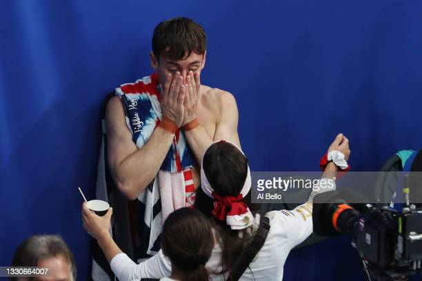 Tom Daley of Team Great Britain celebrates after winning gold in the Men's Synchronised 10m Platform Final on day three of the Tokyo 2020 Olympic...