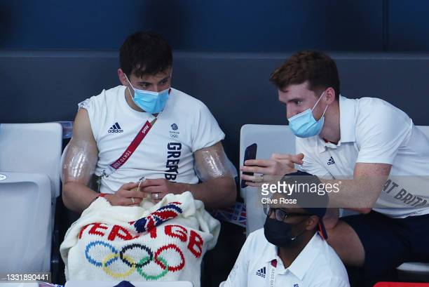 Tom Daley of Team Great Britain knits during the Men's 3m Springboard Preliminary Round on day ten of the Tokyo 2020 Olympic Games at Tokyo Aquatics...