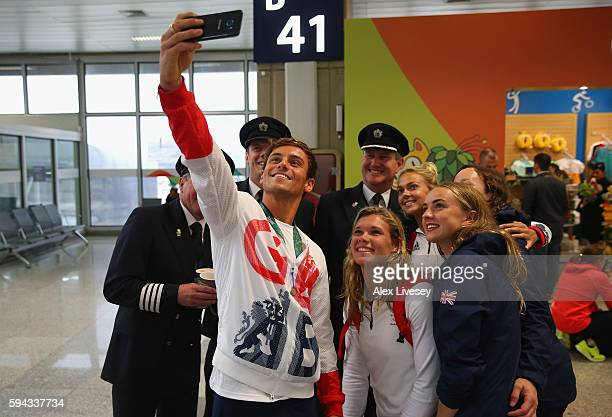 Tom Daley Tonia Couch and Lois Toulson of Great Britain take a selfie with British Airways Captain Steve Hawkins and his crew as Team GB prepare to...