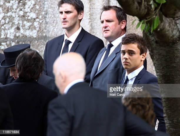 Tom Daley waits for the arrival of the coffin carrying his father Robert Daley at St Mary's Church on June 8 2011 in Plympton England British diving...