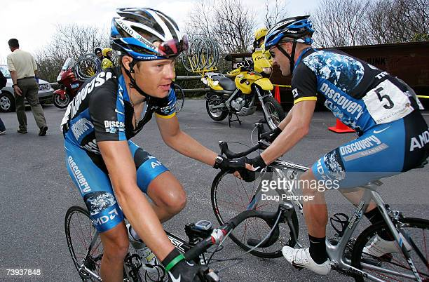 Tom Danielson left in second place of the USA and riding for the Discovery Channel Pro Cycling Team congratulates teammate Levi Leipheimer of the USA...