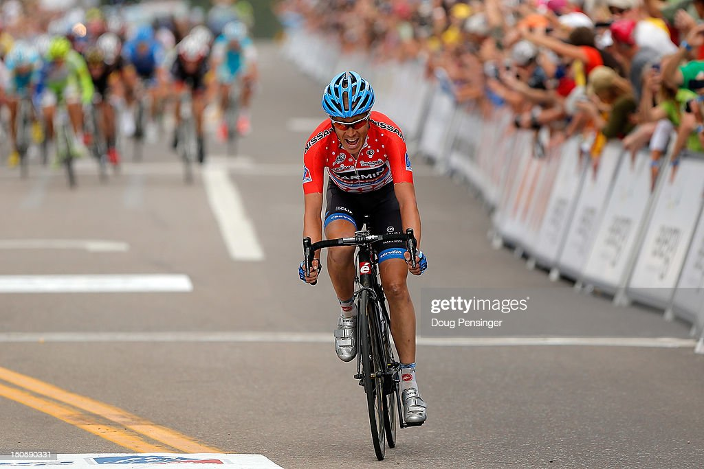 Tom Danielson of the USA riding for Garmin-Sharp crosses the finish line two seconds ahead of the chasing group to win stage three of the USA Pro Challenge from Gunnison to Aspen on August 22, 2012 in Aspen, Colorado.