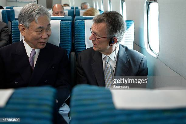 Tom Daschle former US senator of South Dakota and chairman of the advisory board at the Northeast Maglev LLC right speaks to Yoshiyuki Kasai chairman...