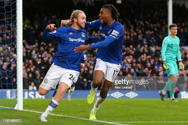Tom Davies and Alex Iwobi of Everton celebrate their team's third goal during the Premier League match between Everton FC and Chelsea FC at Goodison...