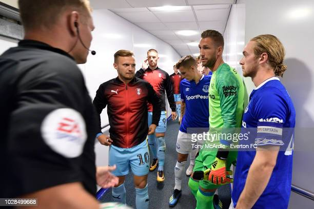 Tom Davies and Maarten Stekelenburg Everton with David Ball of Rotherham before the Carabao Cup second round match between Everton and Rotherham...