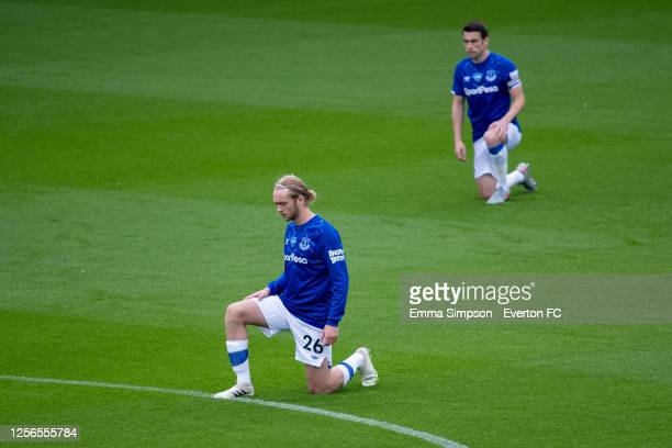 Tom Davies and Seamus Coleman of Everton takes the knee during the Premier League match between Everton FC and Aston Villa at Goodison Park on July...
