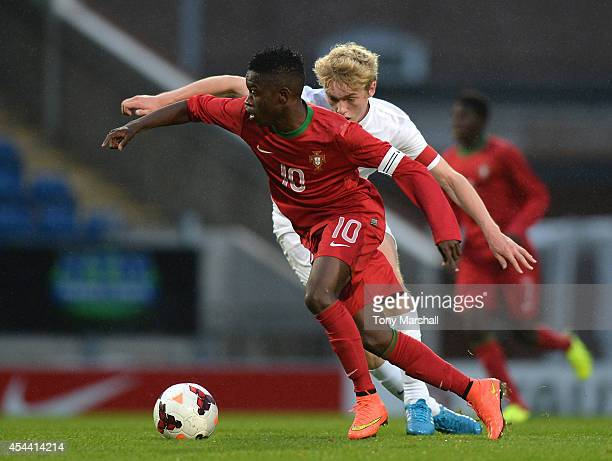 Tom Davies of England challenges Moreto of Portugal during the Under 17 International match between England U17 and Portugal U17 at Proact Stadium on...