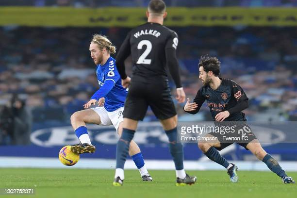 Tom Davies of Everton and Bernardo Silva challenge for the ball during the Premier League match between Everton and Manchester City at Goodison Park...