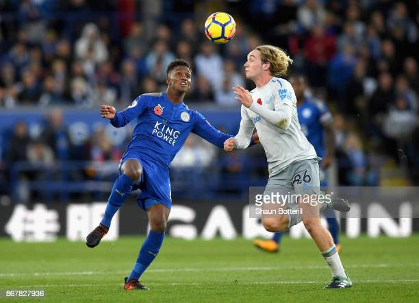Tom Davies of Everton and Demarai Gray of Leicester City battle for the ball during the Premier League match between Leicester City and Everton at...