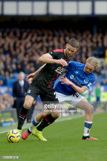 Tom Davies of Everton and Gary Cahill challenge for the ball during the Premier League match between Everton and Crystal Palace at Goodison Park on...