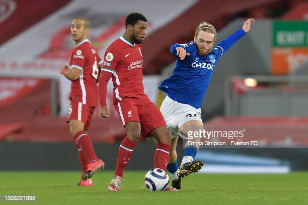 Tom Davies of Everton and Georginio Wijnaldum challenges for the ball during the Premier League match between Liverpool and Everton at Anfield on...