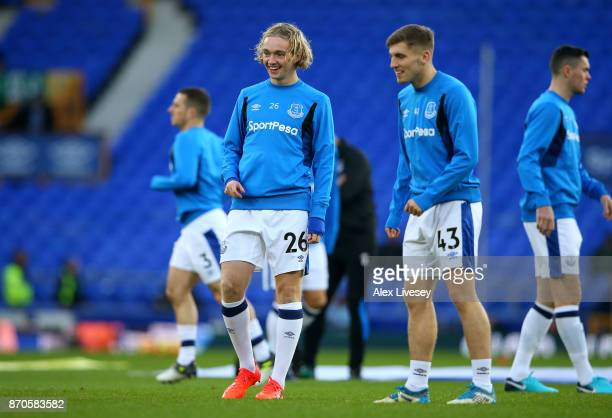 Tom Davies of Everton and Jonjoe Kenny of Everton warm up prior to the Premier League match between Everton and Watford at Goodison Park on November...