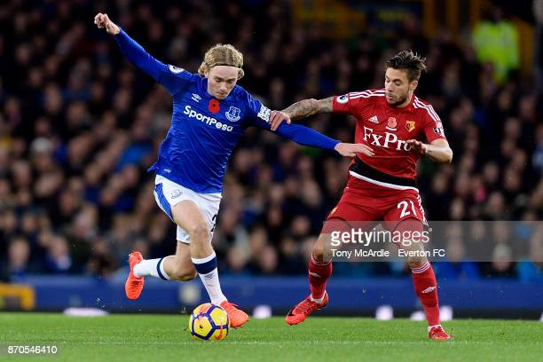 Tom Davies of Everton and Kiko Femenia challenge for the ball during the Premier League match between Everton and Watford at Goodison Park on...