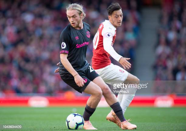 Tom Davies of Everton and Mesut Ozil of Arsenal during the Premier League match between Arsenal FC and Everton FC at the Emirates Stadium on...