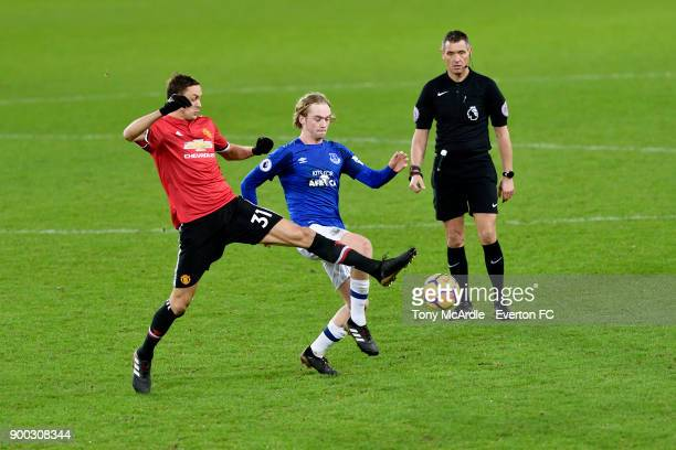 Tom Davies of Everton and Nemanja Matic challenge for the ball during the Premier League match between Everton and Manchester United at Goodison Park...