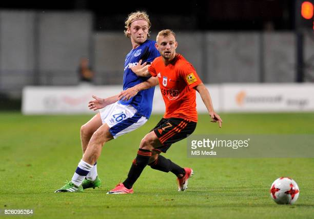 Tom Davies of Everton and Peter Gal Andrezly of Ruzomberok in action during the UEFA Europa League Qualifier between MFK Ruzomberok and Everton on...