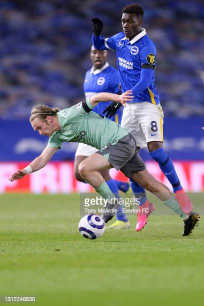 Tom Davies of Everton and Yves Bissouma challenge for the ball during the Premier League match between Brighton and Hove Albion and Everton at the...