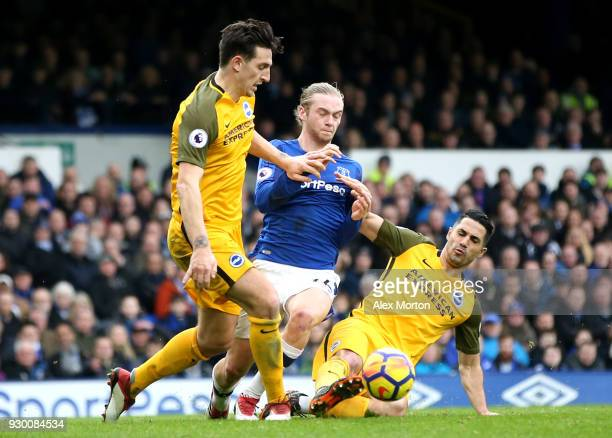 Tom Davies of Everton battles for the ball with Lewis Dunk and Biram Kayal of Brighton and Hove Albion during the Premier League match between...