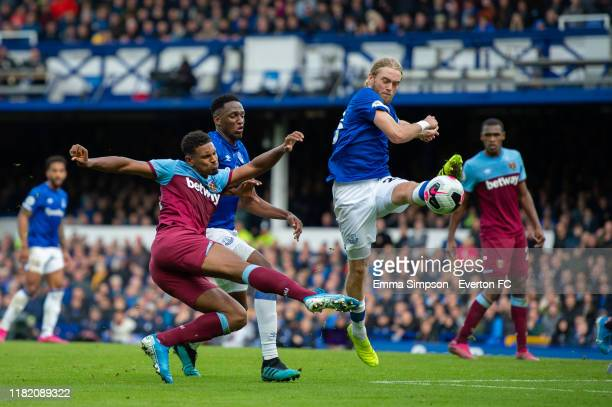 Tom Davies of Everton blocks cross from Sebastien Haller of West Ham United during the Premier League match between Everton FC and West Ham United at...