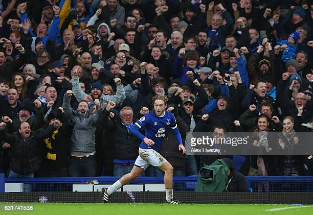 Tom Davies of Everton celebrates after scoring his team's third goal during the Premier League match between Everton and Manchester City at Goodison...