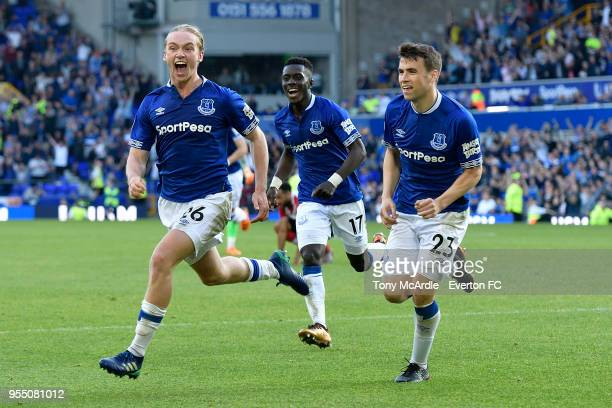 Tom Davies of Everton celebrates his goal with Seamus Coleman and Idrissa Gueye during the Premier League match between Everton and Southampton at...