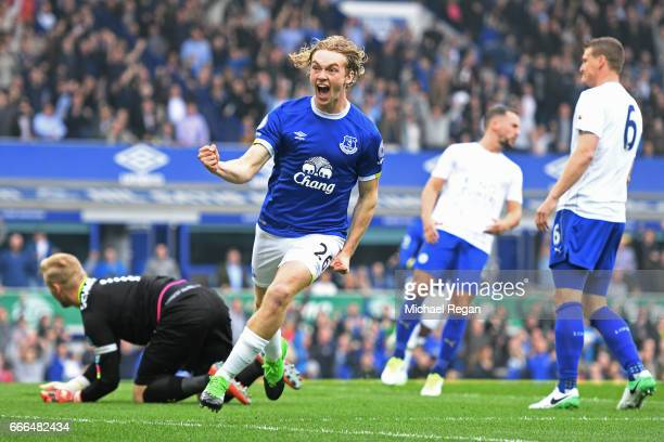 Tom Davies of Everton celebrates scoring the opening goal during the Premier League match between Everton and Leicester City at Goodison Park on...