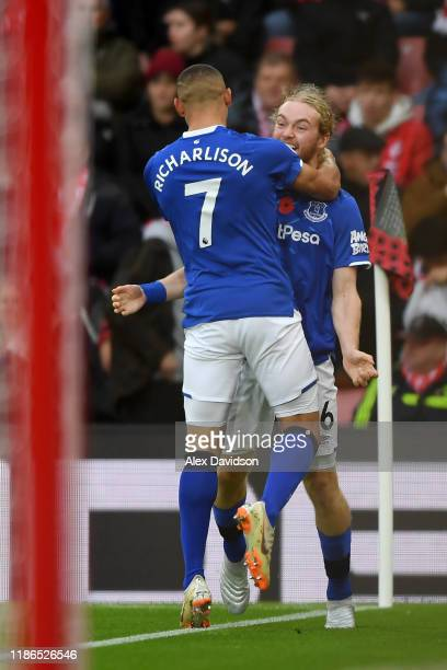 Tom Davies of Everton celebrates with teammate Richarlison after scoring his team's first goal during the Premier League match between Southampton FC...