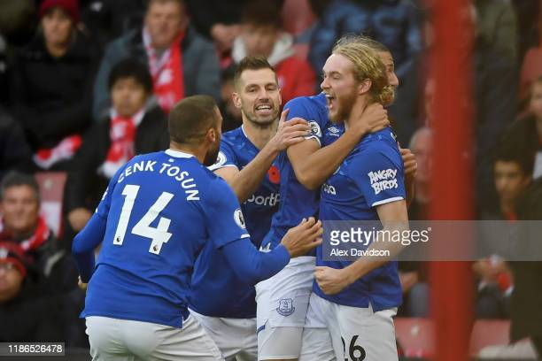 Tom Davies of Everton celebrates with teammates after scoring his team's first goal during the Premier League match between Southampton FC and...