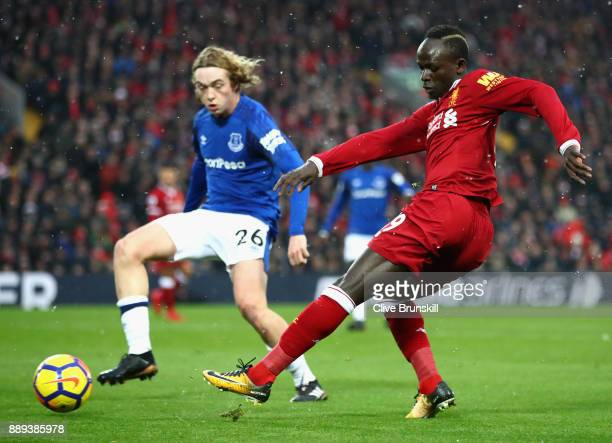 Tom Davies of Everton chases down Sadio Mane of Liverpool during the Premier League match between Liverpool and Everton at Anfield on December 10...