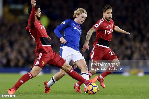 Tom Davies of Everton in a midfield tussle with Miguel Angel Britos during the Premier League match between Everton and Watford at Goodison Park on...