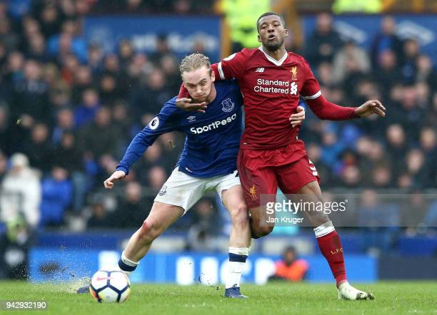 Tom Davies of Everton is challenged by Georginio Wijnaldum of Liverpool during the Premier League match between Everton and Liverpool at Goodison...