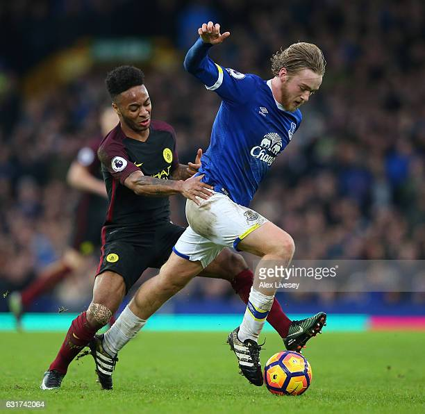 Tom Davies of Everton is challenged by Raheem Sterling of Manchester City during the Premier League match between Everton and Manchester City at...