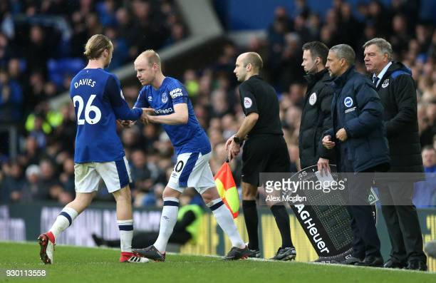 Tom Davies of Everton is substituted off as Davy Klaassen of Everton comes on during the Premier League match between Everton and Brighton and Hove...