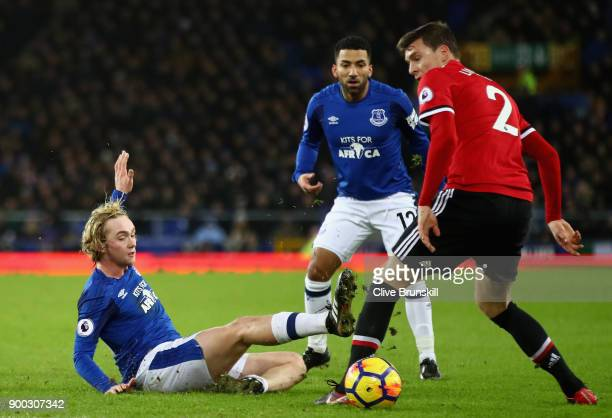 Tom Davies of Everton is tackled by Victor Lindelof of Manchester United during the Premier League match between Everton and Manchester United at...