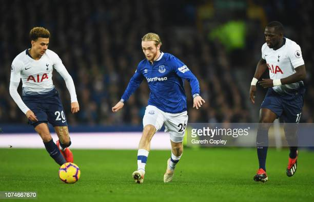Tom Davies of Everton is watched by Dele Alli and Moussa Sissoko of Tottenham Hotspur during the Premier League match between Everton FC and...