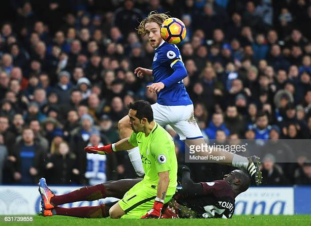 Tom Davies of Everton lifts the ball over goalkeeper Claudio Bravo of Manchester City to score his team's third goal during the Premier League match...