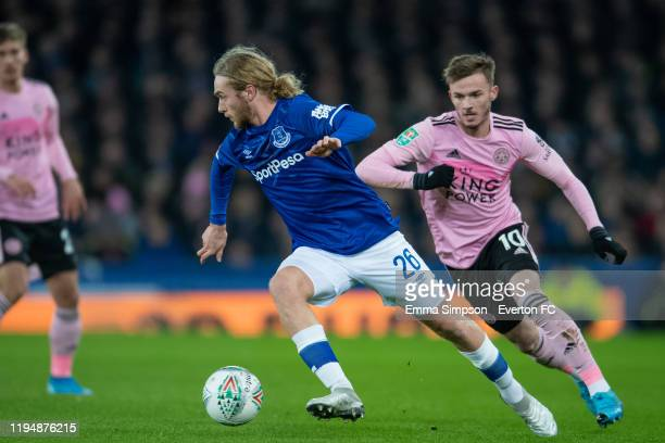 Tom Davies of Everton on the ball followed by James Maddison of Leicester City during the Carabao Cup Quarter Final match between Everton FC and...
