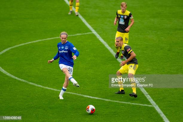 Tom Davies of Everton passes the ball during the Premier League match between Everton FC and Southampton FC at Goodison Park on July 09 2020 in...