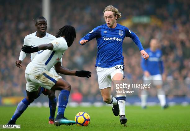 Tom Davies of Everton runs with the ball under pressure from N'Golo Kante of Chelsea and teammate Victor Moses during the Premier League match...