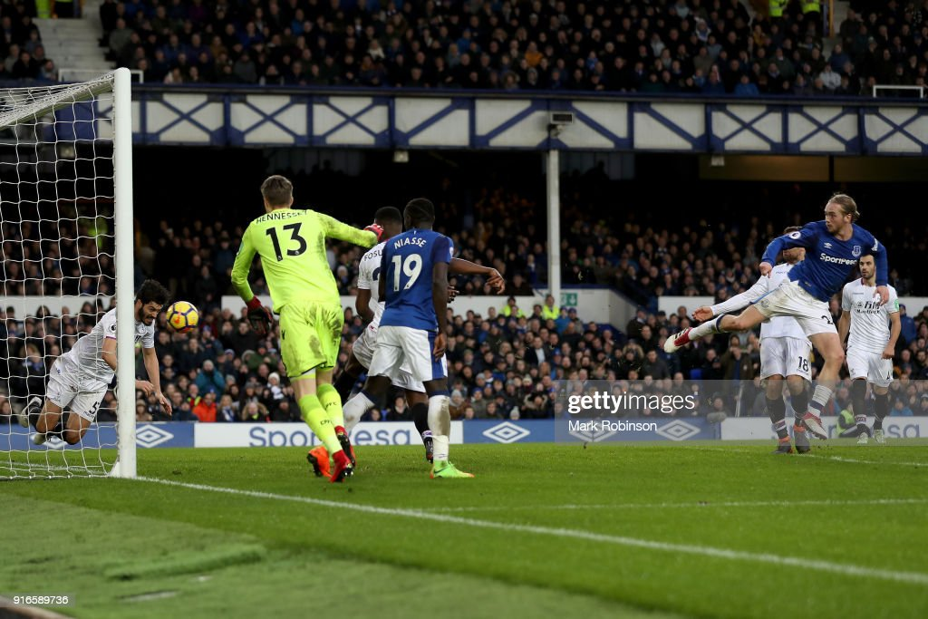 Tom Davies of Everton shoots and scores his side's third goal during the Premier League match between Everton and Crystal Palace at Goodison Park on February 10, 2018 in Liverpool, England.
