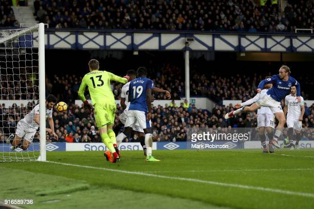 Tom Davies of Everton shoots and scores his side's third goal during the Premier League match between Everton and Crystal Palace at Goodison Park on...