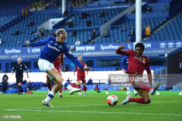 Tom Davies of Everton shoots but hits the post as Joe Gomez of Liverpool tries to block during the Premier League match between Everton FC and...